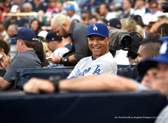 Los Angeles Dodgers Dave Roberts smiles during game against the San Diego Padres Monday, April 4, 2016 at Petco Park in San Diego,California. The Dodgers beat the Padres 15-0