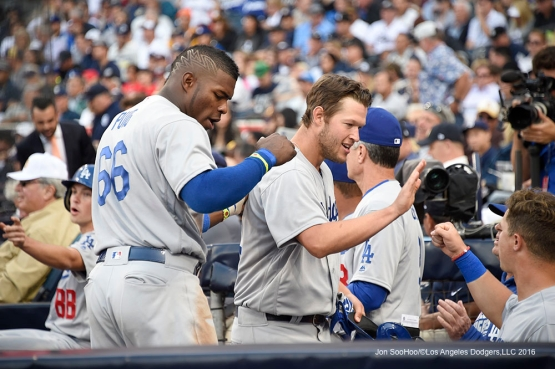 Los Angeles Dodgers Yasiel Puig and Clayton Kershaw greeted in the dugout during game against the San Diego Padres Monday, April 4, 2016 at Petco Park in San Diego,California. The Dodgers beat the Padres 15-0