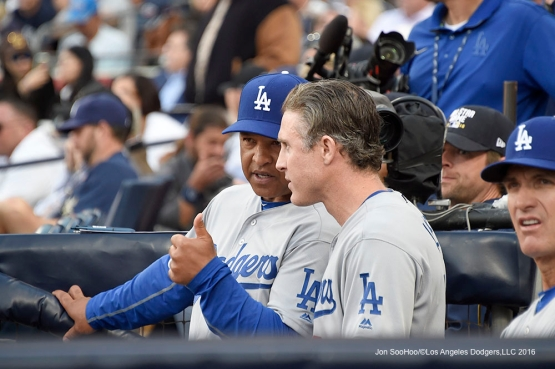 Los Angeles Dodgers Dave Roberts and Chase Utley talk during game against the San Diego Padres Monday, April 4, 2016 at Petco Park in San Diego,California. The Dodgers beat the Padres 15-0