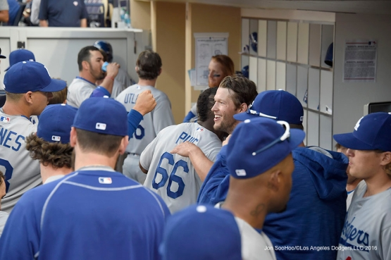 Los Angeles Dodgers Yasiel Puig and Clayton Kershaw hug during game against the San Diego Padres Monday, April 4, 2016 at Petco Park in San Diego,California. The Dodgers beat the Padres 15-0