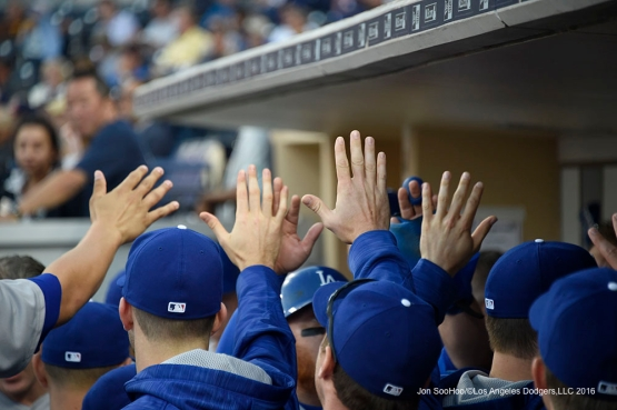Los Angeles Dodgers high fives in the dugout during game against the San Diego Padres Monday, April 4, 2016 at Petco Park in San Diego,California. The Dodgers beat the Padres 15-0