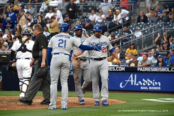Los Angeles Dodgers Trayce Thompson greets Adrian Gonzalez and Yasiel Puig after scoring during game against the San Diego Padres Monday, April 4, 2016 at Petco Park in San Diego,California. The Dodgers beat the Padres 15-0