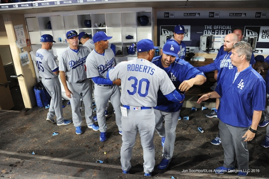 Los Angeles Dodgers Dave Roberts is hugged by Adrian Gonzalez after game against the San Diego Padres Monday, April 4, 2016 at Petco Park in San Diego,California. The Dodgers beat the Padres 15-0
