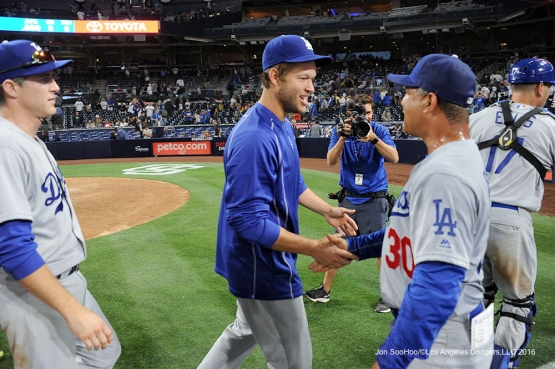 Los Angeles Dodgers Clayton Kershaw and Dave Roberts shake hands after game against the San Diego Padres Monday, April 4, 2016 at Petco Park in San Diego,California. The Dodgers beat the Padres 15-0