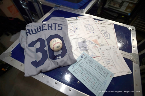 Los Angeles Dodgers Manager Dave Roberts has his first win authenticated Monday, April 4, 2016 at Petco Park in San Diego,California. The Dodgers beat the Padres 15-0