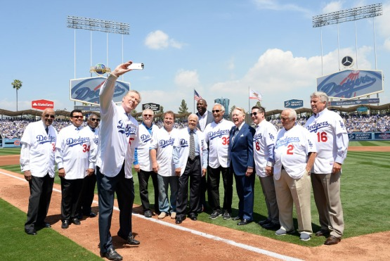 Orel Hershiser takes a selfie with Vin Scully and Magic Johnson along with some former Dodgers. Jill Weisleder/LA Dodgers