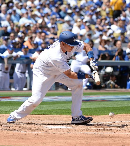 Catcher A.J. Ellis lays down a bunt. Jill Weisleder/LA Dodgers