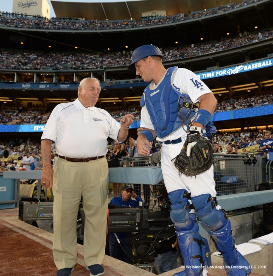 Tommy Lasorda speaks to catcher A.J. Ellis prior to the start of the game. Jill Weisleder/Dodgers