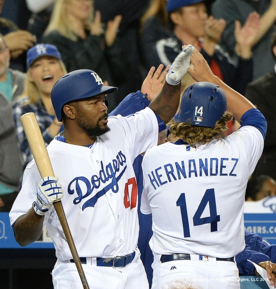 Howie Kendrick high-fives Kike Hernandez as he scores in a run. Jill Weisleder/Dodgers