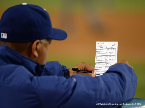 Dodger manager Dave Roberts reviews the line-up during the game. Jill Weisleder/Dodgers