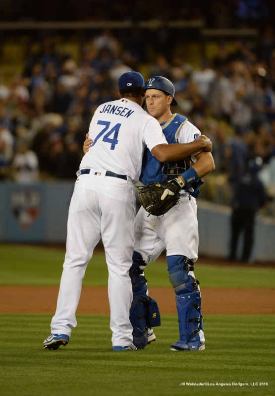 A.J. Ellis hugs Kenley Jansen after the Dodgers take the 5-2 win against the Arizona Diamondbacks. Jill Weisleder/Dodgers