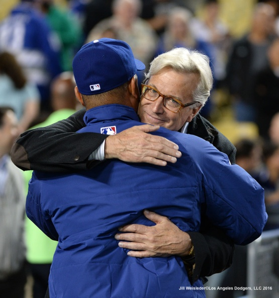 Guggenheim Baseball Management and Dodger owner Mark Walter hugs manager Dave Roberts after the Dodgers take a 5-2 win against the Arizona Diamondbacks. Jill Weisleder/Dodgers