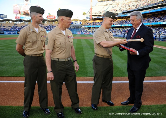 The Marines of Second Battalion, Twenty Third Marines, Fourth Marines Division present an award to Rick Monday to commemorate the 40th Anniversary of Rick Monday saving the American Flag here at Dodger Stadium.
