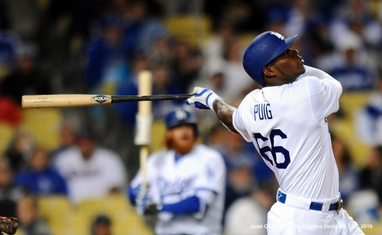Yasiel Puig connects for a solo home run.