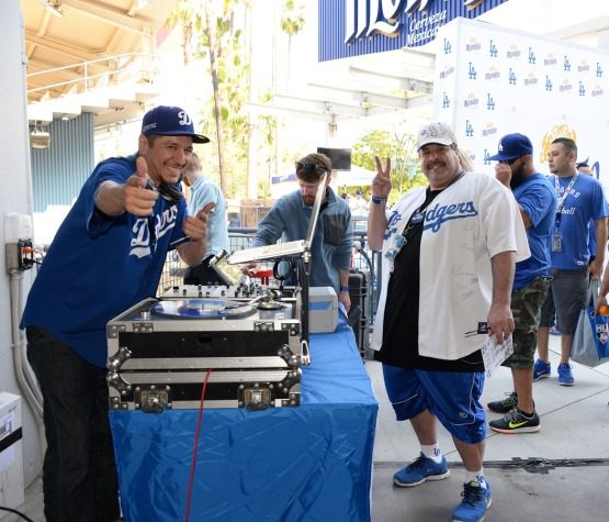 Fans listen to the sounds of the Dodger DJ in the plaza prior to the start of the game. Jill Weisleder/LA Dodgers