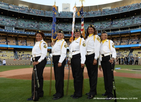 Color guard crew poses for a photo on the grounds at Dodger Stadium. Jill Weisleder/Dodgers