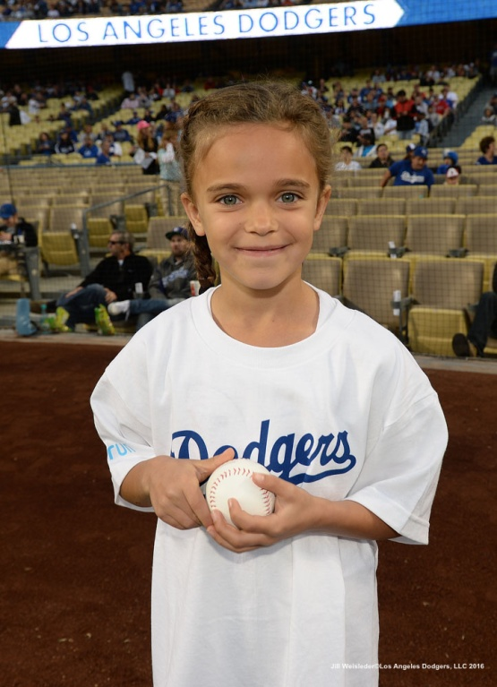 A young Dodger fan patiently waits to get her ball signed. Jill Weisleder/LA Dodgers