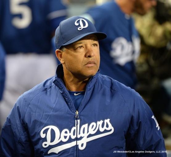 Dodger skipper Dave Roberts looks on from the dugout during the game. Jill Weisleder/LA Dodgers