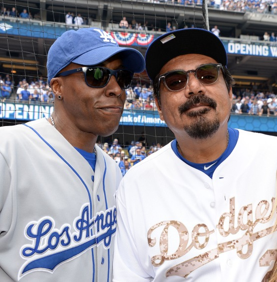 Long time Dodger fans Arsenio Hall and George Lopez pose for a photo on the field. Jill Weisleder/LA Dodgers
