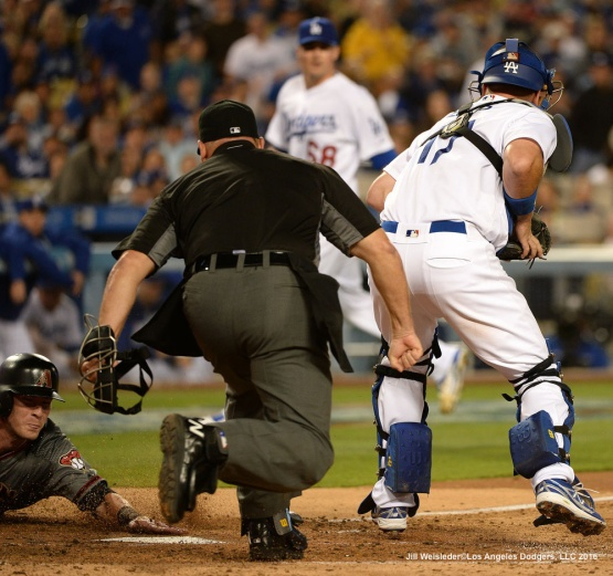 Arizona Diamondbacks' Chris Hermann slides safely at home-plate to score in a run in the fifth inning. Jill Weisleder/Dodgers