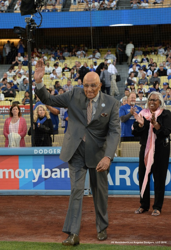 Former Dodger Don Newcombe who played with Jackie Robinson waves to the crowd as as he is introduced during pre-game festivities. Jill Weisleder/Dodgers
