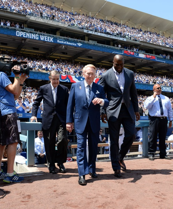 "Peter O'Malley, Vin Scully and Earvin ""Magic"" Johnson walk to the mound for pre-game festivities. Jill Weisleder/LA Dodgers"