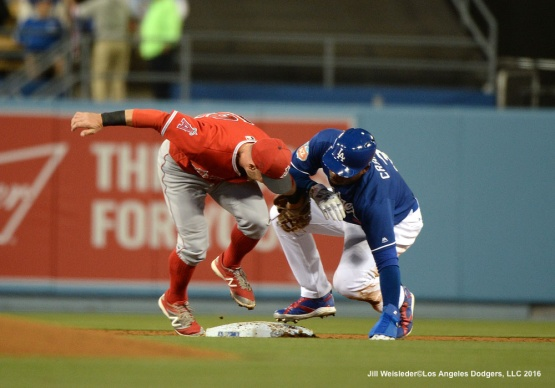Angels' second basemen Johnny Giavotella applies the tag and gets out Carl Crawford. Jill Weisleder/LA Dodgers