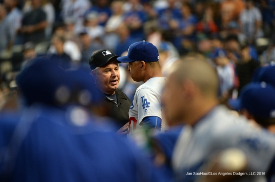 Los Angeles Dodgers Dave Roberts talks with Umpire Tom Hallion during game against the New York Mets Saturday, May 28, 2016 at Citi Field in Flushing,New York.