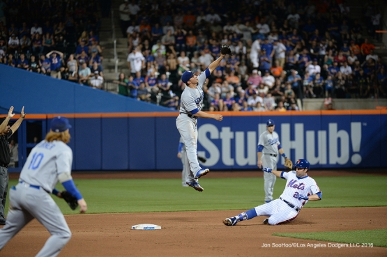 Los Angeles Dodgers Corey Seager goes up for ball against the New York Mets Saturday, May 28, 2016 at Citi Field in Flushing,New York.