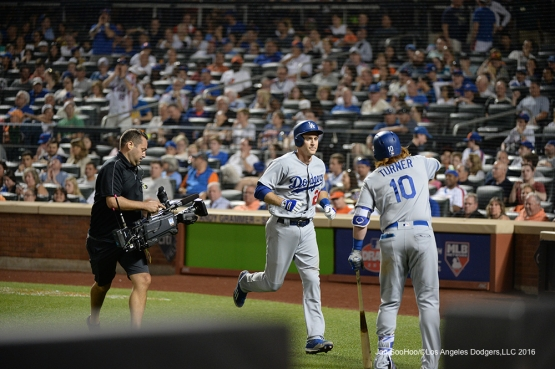 Los Angeles Dodgers Chase Utley is greeted by Justin Turner after home run against the New York Mets Saturday, May 28, 2016 at Citi Field in Flushing,New York.