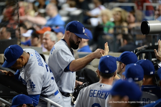 Los Angeles Dodgers Adam Liberatore is greeted in the dugout during game against the New York Mets Saturday, May 28, 2016 at Citi Field in Flushing,New York.