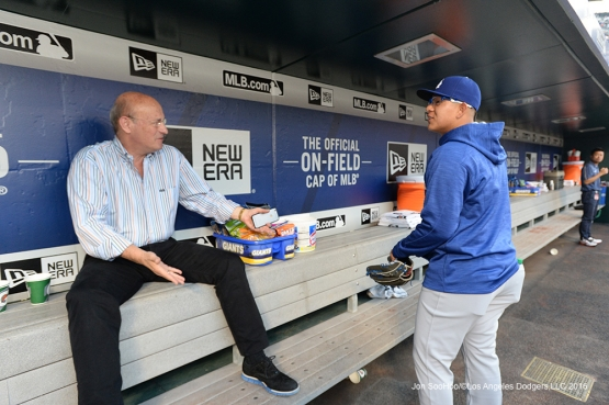 Stan Kasten and Julio Urias chat prior to game against the New York Mets Friday, May 27, 2016 at Citi Field in Flushing,New York.