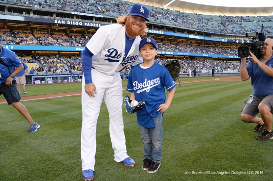 Los Angeles Dodgers Justin Turner poses with Kevin Barron prior to game against the San Diego Padres Saturday, April 30,2016 at Dodger Stadium in Los Angeles,California.