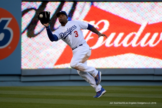Los Angeles Dodgers Carl Crawford runs down ball against the San Diego Padres Saturday, April 30,2016 at Dodger Stadium in Los Angeles,California.