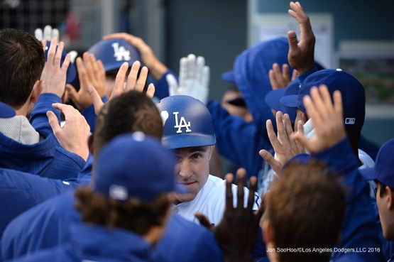 Los Angeles Dodgers Chase Utley is greeted in the dugout after two run homer against the San Diego Padres Saturday, April 30,2016 at Dodger Stadium in Los Angeles,California.