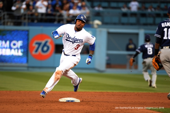 Los Angeles Dodgers Carl Crawford triples against the San Diego Padres Saturday, April 30,2016 at Dodger Stadium in Los Angeles,California.