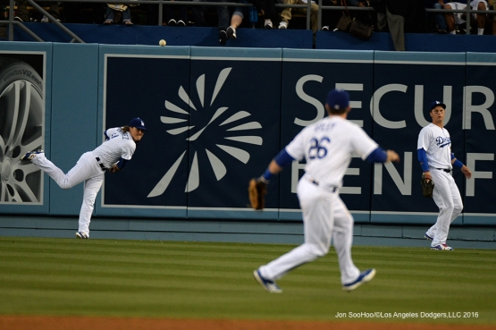 Los Angeles Dodgers Kike Hernandez relays ball to Chase Utley   against the San Diego Padres Saturday, April 30,2016 at Dodger Stadium in Los Angeles,California.