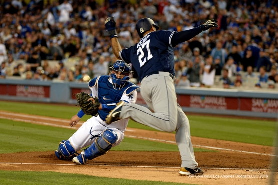 Los Angeles Dodgers Yasmani Grandal can't get Matt Kemp at home Saturday, April 30,2016 at Dodger Stadium in Los Angeles,California.