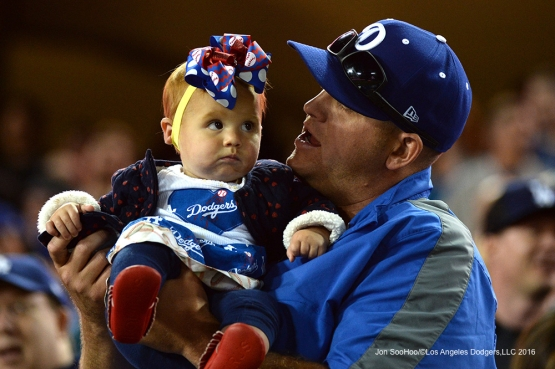 Great young Los Angeles Dodgers fan poses during game against the San Diego Padres Saturday, April 30,2016 at Dodger Stadium in Los Angeles,California.