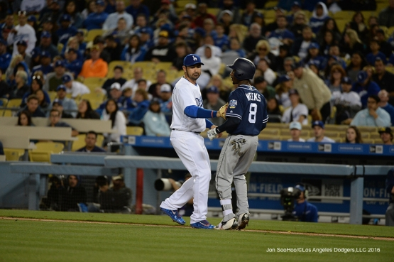 Los Angeles Dodgers Adrian Gonzalez makes the tag against the San Diego Padres Saturday, April 30,2016 at Dodger Stadium in Los Angeles,California.