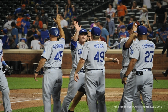 Los Angeles Dodgers Chase Utley celebrates with teammates after win against the New York Mets Saturday, May 28, 2016 at Citi Field in Flushing,New York.