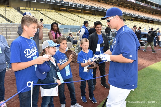 Los Angeles Dodgers Joc Pederson signs prior to game against the Los Angeles Angels of Anaheim Monday, May 16, 2016 at Dodger Stadium in Los Angeles, California.  Jon SooHoo/©Los Angeles Dodgers,LLC 2016