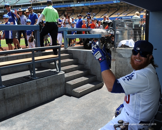 Los Angeles Dodgers Justin Turner waves to little leaguers on parade prior to game against the San Diego Padres Sunday, May 1,2016 at Dodger Stadium in Los Angeles,California.