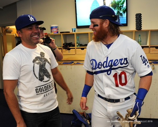 Oscar De La Hoya is greeted by Los Angeles Dodgers Justin Turner prior to game against the San Diego Padres Sunday, May 1,2016 at Dodger Stadium in Los Angeles,California.
