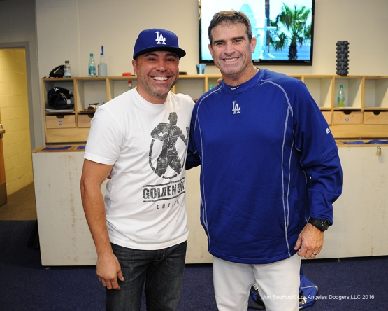 Oscar De La Hoya poses with hitting coach Turner Ward prior to game against the San Diego Padres Sunday, May 1,2016 at Dodger Stadium in Los Angeles,California.