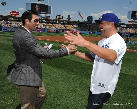 Nomar Garciaparra shakes hands with Oscar De La Hoya prior to game against the San Diego Padres Sunday, May 1,2016 at Dodger Stadium in Los Angeles,California.