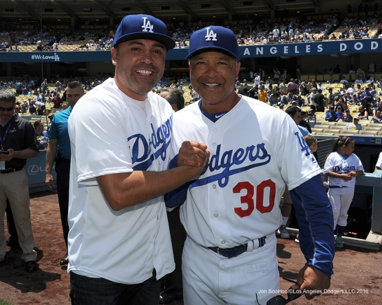 OscarDeLa Hoya and Los Angeles Dodgers manager Dave Roberts pose prior to game against the San Diego Padres Sunday, May 1,2016 at Dodger Stadium in Los Angeles,California.