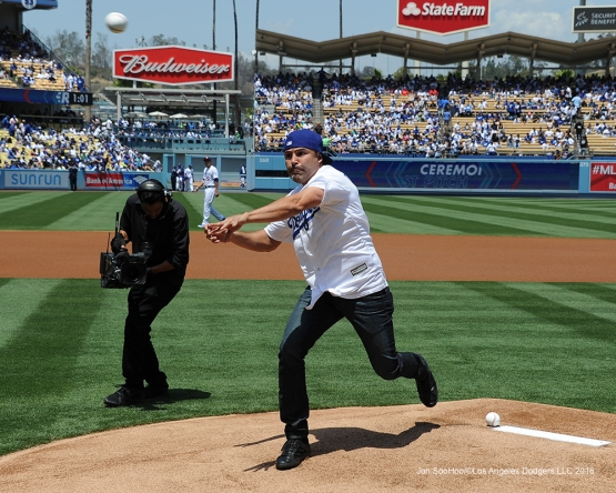 Oscar De La Hoya pitches prior  to game against the San Diego Padres Sunday, May 1,2016 at Dodger Stadium in Los Angeles,California.
