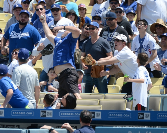 Los Angeles Dodgers fan makes a play during game against the San Diego Padres Sunday, May 1,2016 at Dodger Stadium in Los Angeles,California.