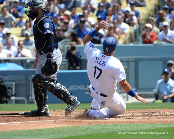 Los Angeles Dodgers  A.J.Ellis is safe at home against the San Diego Padres Sunday, May 1,2016 at Dodger Stadium in Los Angeles,California.